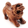 handcarved boxwood ojime bead of temple lion