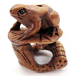 handcarved boxwood ojime bead of frog on lily