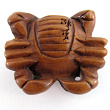 handcarved boxwood ojime bead of crab showing vertical hole through body