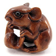 handcarved boxwood ojime bead of mouse with seed