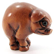 handcarved boxwood ojime bead of grunting pig