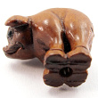 handcarved boxwood ojime bead of pig showing hole through body
