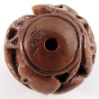 handcarved boxwood ojime bead of cicada ball showing hole through the center