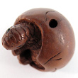 handcarved boxwood ojime bead of dinosaur egg showing hole top to bottom through shell