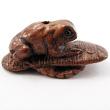 handcarved boxwood ojime bead of frog on sandal