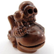 handcarved boxwood ojime bead of skeleton with drum