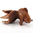 handcarved boxwood ojime bead of fancy fish