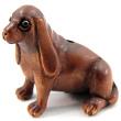 handcarved boxwood ojime bead of hound dog