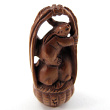 handcarved boxwood ojime bead of bunnies in a basket