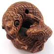 handcarved boxwood ojime bead of chameleon and youngster