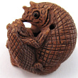handcarved boxwood ojime bead of chameleon and youngster showing hole through center of body