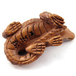 handcarved boxwood ojime bead of alligator showing hole through center of body