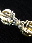 small dorje brass pendant, a ritual object representing firmness of spirit