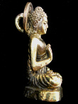 side view of Buddha brass deity pendant, the sage on whose teachings Buddhism was founded