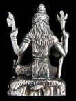 back of Shiva brass deity statue, represented in one of his various forms as a meditating yogi