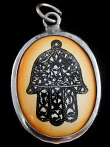Hand of Fatima enamel deity pendant, an ancient symbol used to protect against negativity