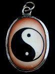 Yin Yang enamel deity pendant, representing the principle of opposites existing in all things