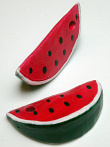 showing two slices, handmade and hand-painted Peruvian ceramic watermelon bead