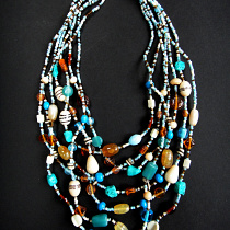 Glass and agate multi-strand Malala Necklace in blue and turquoise tones.