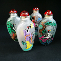 Set of 4 assorted inside-painted glass bottles handmade using traditional techniques