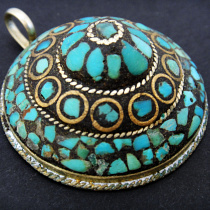 Tibetan style pendant with turquoise, brass and resin