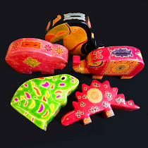 whimsical coin banks handmade in India from natural, painted leather