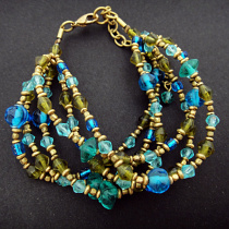Gaia Mulit-strand bracelet with glass and brass beads, handmade in India