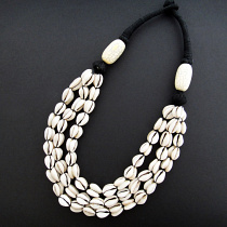 Cowrie Shell Necklace knotted on cotton cord with crackle resin accent beads
