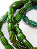 closeup of a Strand of watermelon chevron African Trade Beads, glass beads made in Venice, Italy and traded throughout the world, especially in Africa in the 1900's and earlier.