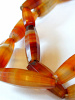 closeup of strand of faceted antique Carnelian stone beads