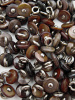 100 pieces of Brown Victorian shell boot-buttons, made in Muscatine, Iowa