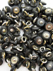 100 pieces of Charcoal Victorian shell boot-buttons, made in Muscatine, Iowa