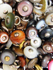 100 pieces of mulit-color Victorian shell boot-buttons, made in Muscatine, Iowa