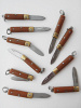 showing an assortment of ten brown Mini knives that open and close