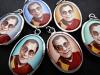 Assortment of His Holiness, the Dalai Lama pendants, exiled Spiritual leader of Tibet, and Nobel Peace Prize winner.