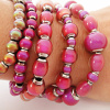 Assorted color-changing Hot Pink Mirage beads on an elastic bracelet