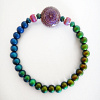 color-changing Micro Mirage Bead stretch bracelet with Sun-Blossom center bead