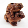 handcarved boxwood ojime bead of pair of frogs