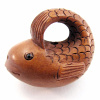 handcarved boxwood ojime bead of whale