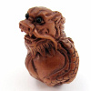 handcarved boxwood ojime bead of dragon