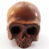 handcarved boxwood ojime bead of skull