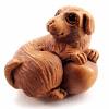 handcarved boxwood ojime bead of dog