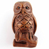 handcarved boxwood ojime bead of owl on branch