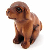 handcarved boxwood ojime bead of puppy