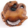 handcarved boxwood ojime bead of circle horse