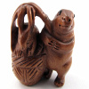 handcarved boxwood ojime bead of bunny with basket
