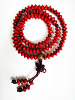 Prayer bead mala strand of 108 rondell-shaped seeds from the Red Sandalwood Tree