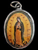 Virgin of Guadalupe enamel deity pendant, the patron saint of Mexico.