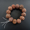 Large, natural rudraksha seeds strung on stretch elastic
