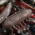closeup detail of antique silver jewelry